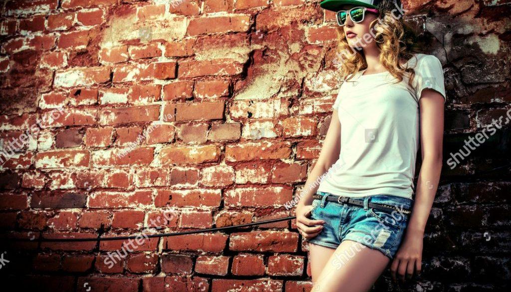 stock-photo-beautiful-modern-girl-near-the-brickwall-youth-style-fashion-shot-218173297